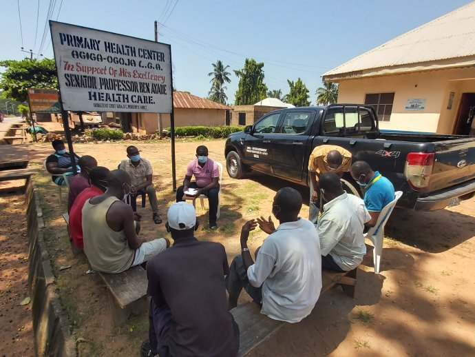 Community members gather during a listening session in Cross River State Nigeria.
