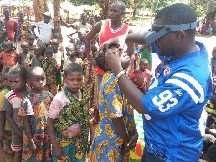 Children queue to have their eyes examined for trachoma.