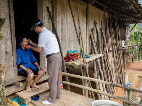 A woman has her eyes examined for trachoma in Vietnam.