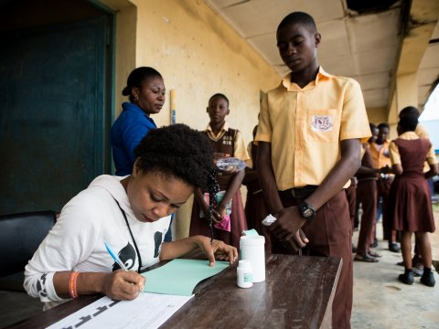 Students receive medicines during an NTD treatment campaign in Nigeria.