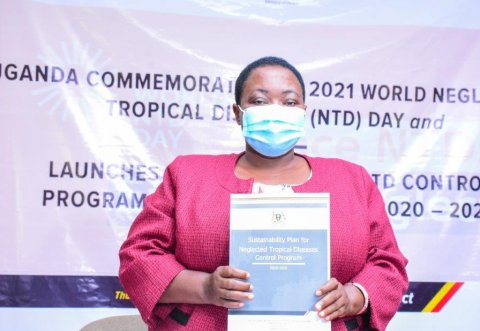 Uganda: the Honorable Minister of State for Health, Hon. Rhobinah Nabbanja holds the newly launched Sustainability Plan for Neglected Tropical Diseases