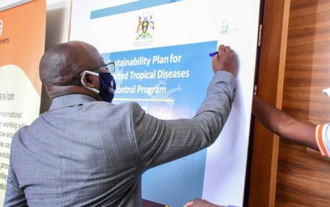 Dr. Alfred Mubangizi, Ag. Asst. Commissioner for Vector Borne and NTDs Division at the Uganda Ministry of Health signs the sustainability plan the launch on February 4, 2021.