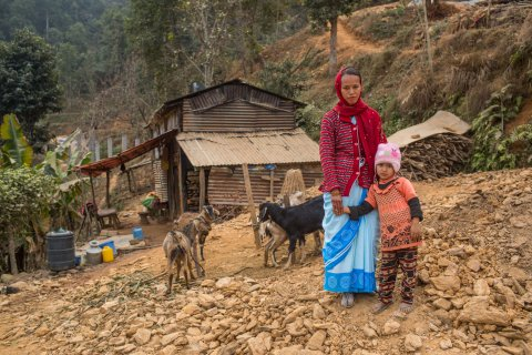 A female community health volunteer (FCHV), with her daughter in front of their home. Photo by Nabin Baral for RTI International