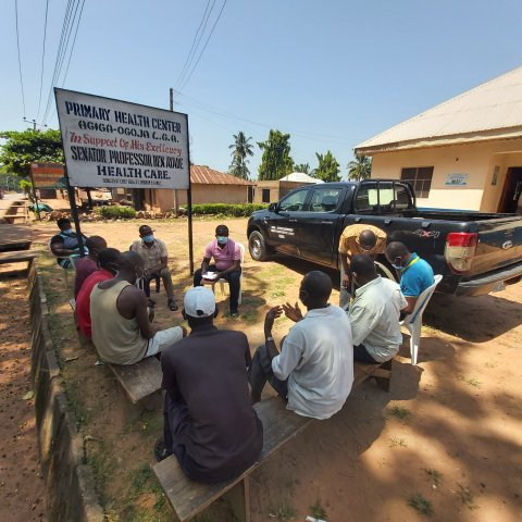 Community members gather for a listening session in Cross River State Nigeria.