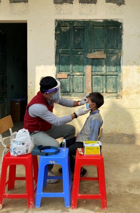 A child has their eyes examined for trachoma during a survey in Vietnam.