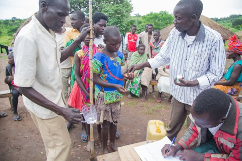 A community receives treatment for onchocerciasis in Uganda.