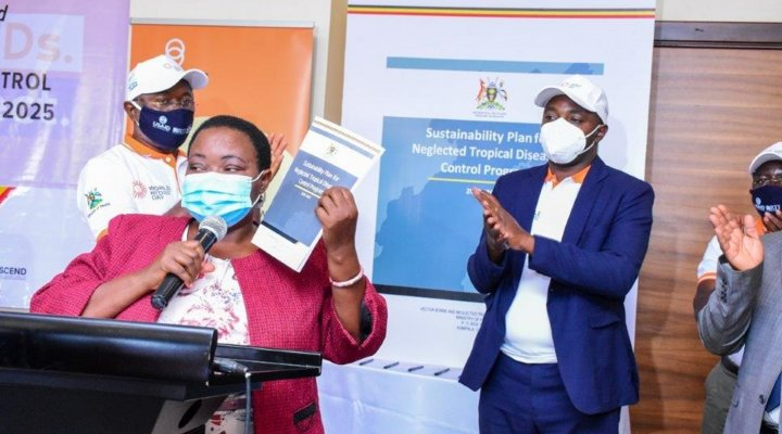 Participants applaud as Hon. Minister of State for Health, Hon. Rhobinah Nabbanja announces the official launch of Uganda's Sustainability Plan for Neglected Tropical Diseases.